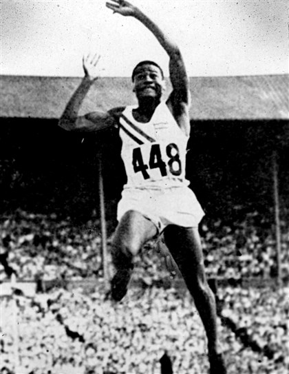 Herb Douglas takes off Herb Douglas takes off during one of his jumps at the 1948 Olympics. At 92, Mr. Douglas is the oldest living black Olympic medalist.