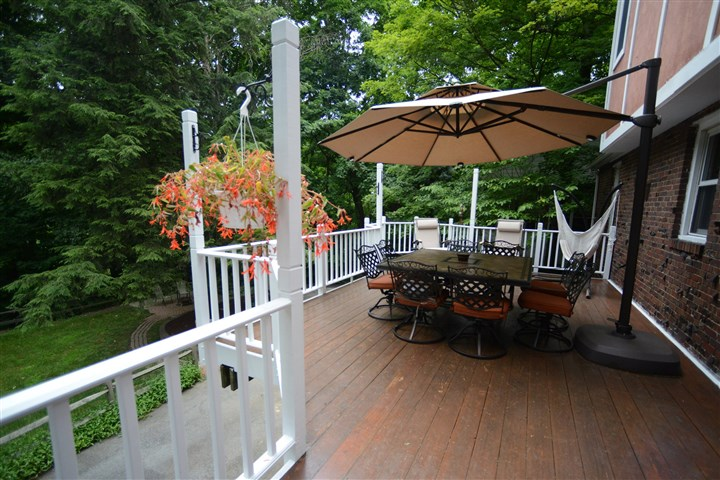 15-by-14-foot deck The 15-by-14-foot deck provides a view of the spacious fenced-in backyard.