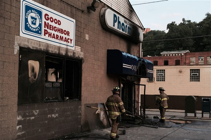 20140707ds_waltmirepharmacyfire City of Pittsburgh firefighters return on a call for a rekindle at Waltmire Pharmacy along Spring Garden Avenue in the Spring Garden neighborhood.