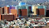 A shot from the Hill District overlooks the new Children's Hospital in Lawrenceville. Unlike many other sectors, job cuts at Western Pennsylvania hospitals have continued since the 2008 recession, with regional hospitals collectively reporting a sixfold increase in reductions last fiscal year.