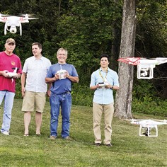 Pittsburgh Drone Masters members  From left: Rich Manko of Sewickley, Tom Reinsel of Franklin Park, Max Richardson of Sewickley and Micah Rosa of the South Side, are Pittsburgh Drone Masters members with some of their quadcopter drones in Blueberry Hill Park.
