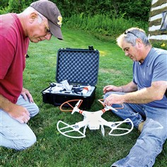Rich Manko and Max Richardson of Seweickley Rich Manko of Sewickley, left, and Max Richardson of Seweickley, prepare a quadcopter drone to fly in Blueberry Park, as the Pittsburgh Drone Masters members meet.