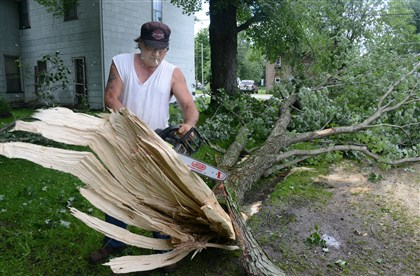 Jerry Swogger uses a chain saw Jerry Swogger uses a chain saw to cut up a large silver maple branch. Mr. Swoffer used a chain and his truck to drag the branch off Main Street in Jackson Center.