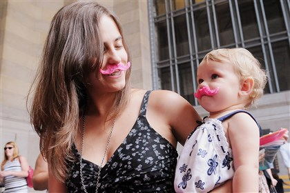 Lara and Razlyn Flavin Lara and Razlyn Flavin, 1, sport pink mustaches in support of ride-sharing company Lyft today.