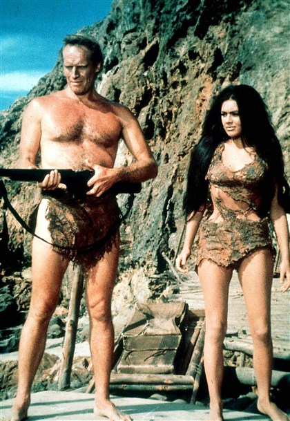 "1968planetofapes Charlton Heston, who plays an astronaut who lands on an ape-ruled planet, and Linda Harrison, as a human inhabitant, appear in a scene from the 1968 film ""The Planet of the Apes."""