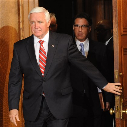 Corbett enters to sign budget Gov. Tom Corbett arrives for today's news conference in Harrisburg.