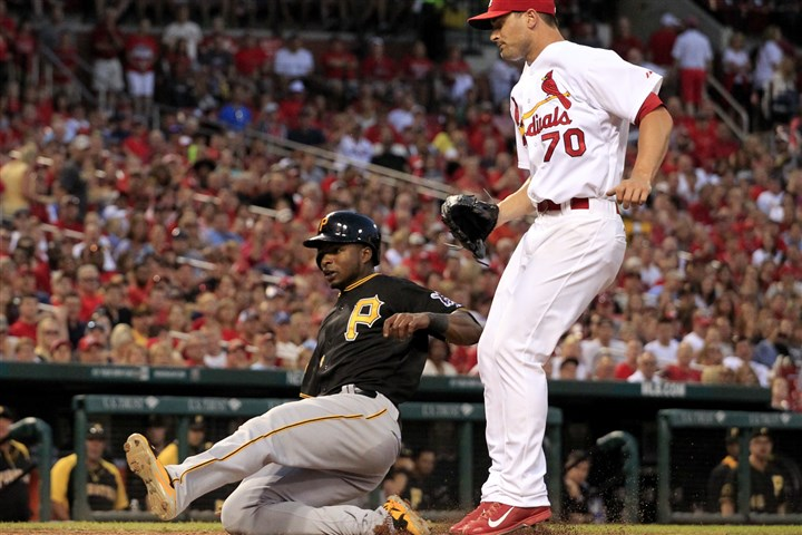 Gregory Polanco scores Gregory Polanco, left, scores on a passed ball as Cardinals relief pitcher Tyler Lyons covers home Thursday in St. Louis.