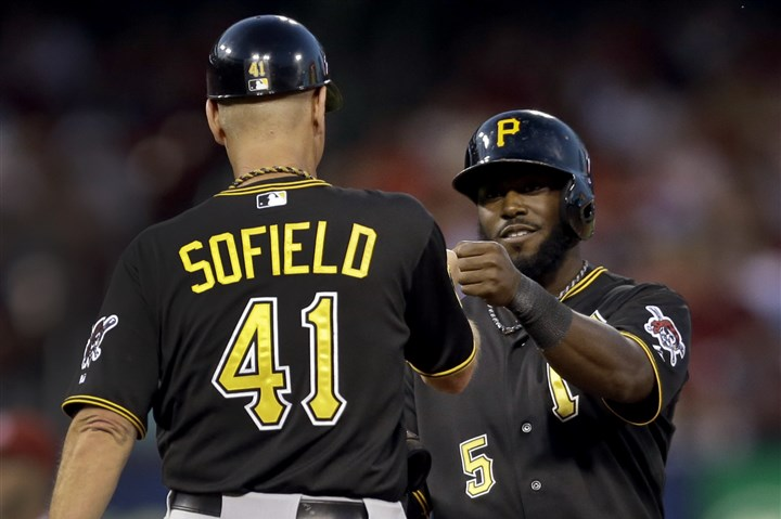 Josh Harrison exchanges a fist bump with Rick Sofield  Josh Harrison exchanges a fist bump with first-base coach Rick Sofield after hitting a ground-rule double with the bases loaded in the sixth inning, capping off four-run inning and a seven-run outburst over the fifth and sixth that helped the Pirates salvage the fourth game of the series in St. Louis.