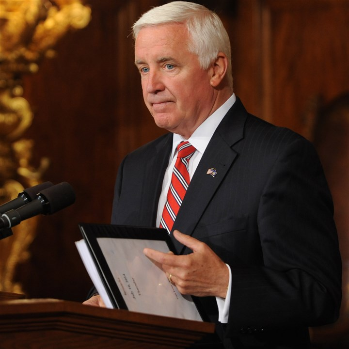 corbett3R-1 Pennsylvania Gov. Tom Corbett holds a copy of state budget documents during a news conference Thursday in Harrisburg, Pa.