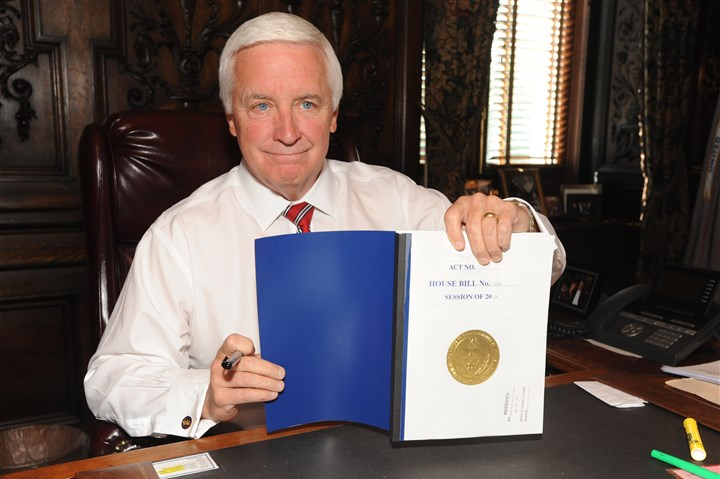 Corbett budget Gov. Tom Corbett holds up the state budget documents he signed in his chambers today.