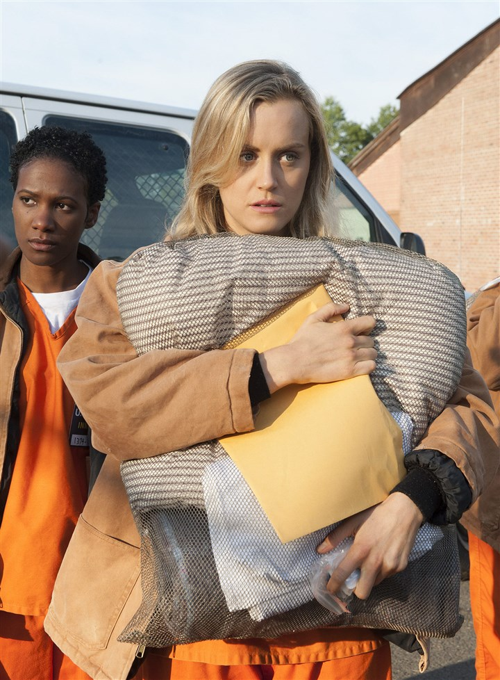 "20140713hoNext_Orange Taylor Schilling portrays in inmate in the women's prison series ""Orange is the New Black"" a streaming series on Netflix."