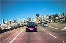 A Lyft car takes to the road.