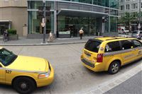 Yellow Cabs line Market Street in Downtown Pittsburgh on May 22, 2014.
