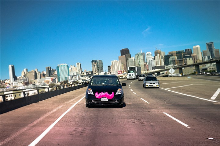 uber071314 A Lyft car takes to the road.