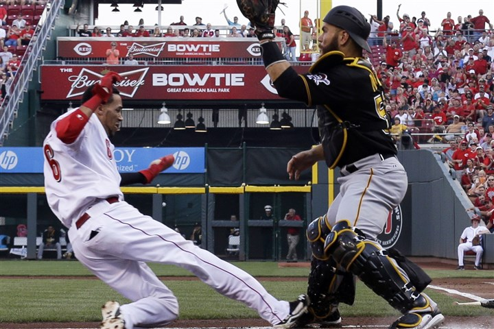 Pirates Reds Baseball The Reds' Billy Hamilton is safe at home as Pirates catcher Russell Martin waits for the ball in the first inning. Hamilton scored on a hit by Zack Cozart.