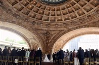 Dave Burrows with his daughter  Dana Burrows, walk up the aisle under the rotunda of The Pennsylvanian, as she prepares to marry  Conor McCaskey, 34, of Dormont.