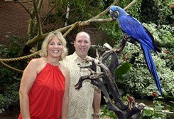 Jane and Michael Dixon with Benito, a hyacinth macaw.