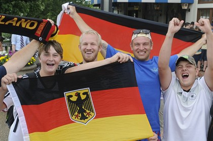 201407132CMWorldCupLocal005-4 Micah Doan, Luke Markovich, Caleb Markovich, and Zac Markovich of Cleveland celebrate the German national soccer team's victory in the World Cup Final outside the Hofbrauhaus restaurant in the South Side. Germany beat Argentina 1-0 in extra time of the World Cup Final.