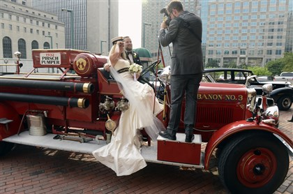 20140712bwWedMag01 After their wedding, Dana Burrows, 33 and Conor McCaskey, 34, are photographed by Sean Hamrock in the 1932 Pirsch pumper retired from the Mt. Lebanon Fire Department.