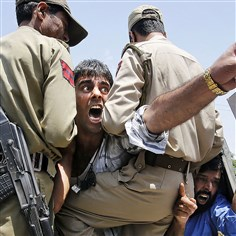 9r200lp1-17 Kashmiri protesters shout slogans Monday against Israel after they were detained during a protest in Srinagar, India. The protest was against the Israeli military operation in the Gaza Strip.
