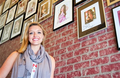 Millennium Dance Complex Pittsburgh owner Tawni Darby  Millennium Dance Complex Pittsburgh owner Tawni Darby poses in front of a wall of dancers who have trained with MDC. The Pittsburgh studio's summer intensive classes began this week.