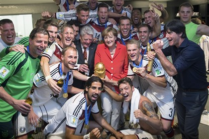 Brazil Soccer WCup German Chancellor Angela Merkel celebrates Germany's World Cup victory with members of the national soccer team.