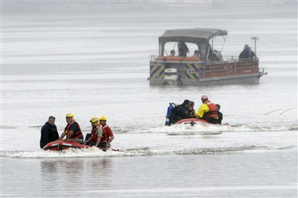 Jet ski accident search Divers from Murrysville Rescue 1's dive team head to shore this morning after searching the Allegheny River for the body of a man thrown from a jet ski Sunday.