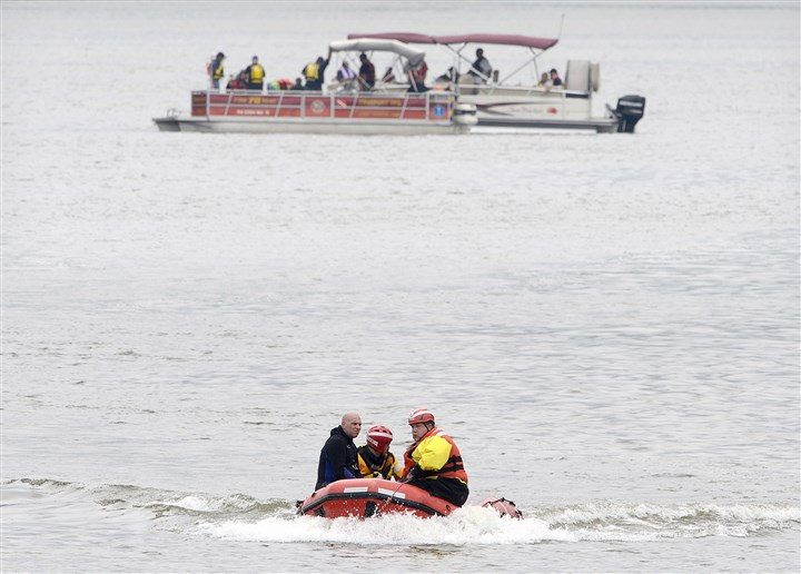 20140714radJetSkiFatalityLocal04 Divers from Murrysville Rescue 1's dive team head to shore this morning after searching the Allegheny River for the body of a man thrown from a jet ski Sunday.