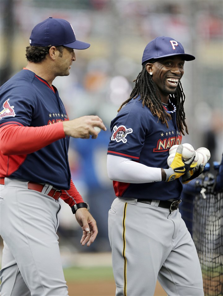 mccutchen0715 National League manager Mike Matheny of the St. Louis Cardinals shares an All-Star moment with Pirates outfielder Andrew McCutchen at a workout Monday at Target Field in Minneapolis.