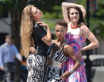 Kyla Stewart, Miyah Knight and Andrea Weinzierl are photographed by photographer Michael Edwards during a pop-up fashion photo shoot in Market Square to promote Style Week Pittsburgh.