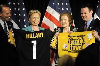 7zh00kcv-2 In this 2008 photo, Sen. Hillary Rodham Clinton shows off a Steelers jersey presented to her at a Allegheny County Democtratic Committee dinner at Heinz Field. With her is Allegheny County Executive Dan Onorato, former Mayor Sophie Masloff and Mayor Luke Ravenstahl.