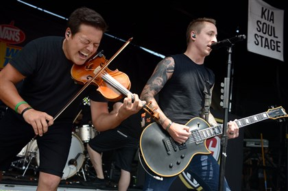 20140715MWHwarpedMag08-11 Lead singer Ryan Key, right, and violinist Sean Mackin of Yellowcard perform at the Vans Warped Tour at First Niagara Pavilion Tuesday.