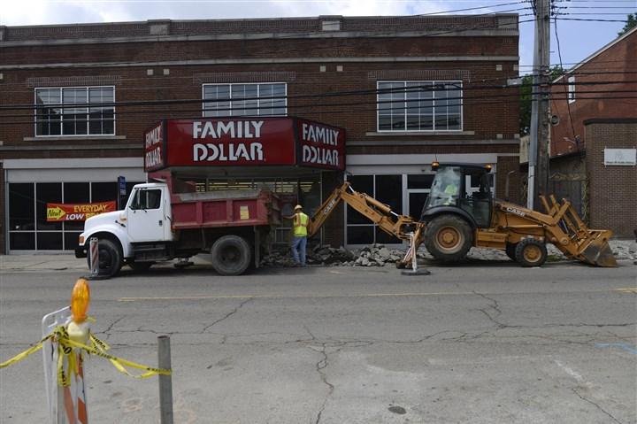 20140715rldBellevueConstruction03-2 Construction workers excavate a sidewalk along Lincoln Avenue in Bellevue Tuesday. The work is part of an Allegheny County green initiative redevelopment plan that includes new sidewalks.