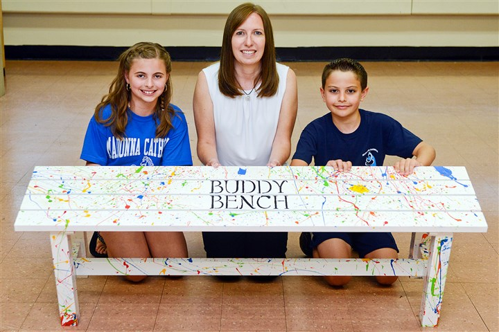 20140714RARsouthbench The Buddy Bench that sits on the playground at Madonna Catholic Regional School in Monongahela. Chelsea Sala, 10, left, helped paint the bench alog with school counselor Michele Ruddock and Lorenzo Zeni, 10.