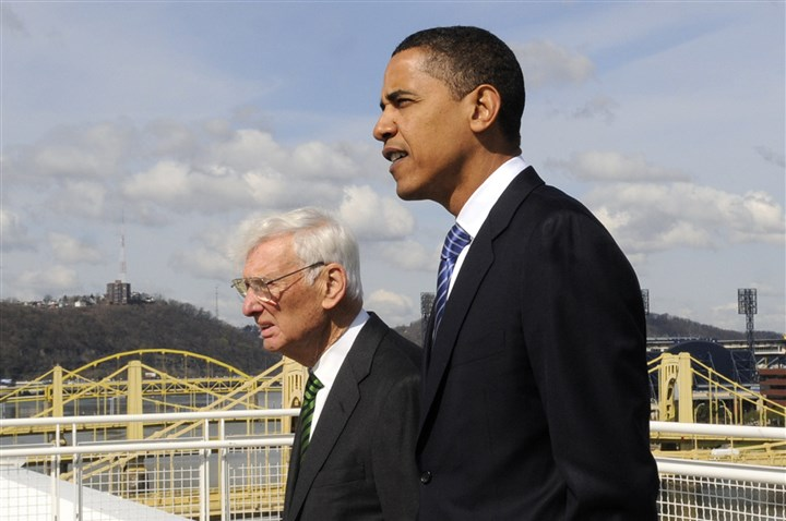 7zl00kde-5 Barack Obama walks with Steelers owner Dan Rooney to rooftop deck of the convention center to get a view of Heinz Field on April 14, 2008. Obama was a senator at the time, seeking the Democratic party nomination, and Rooney endorsed Obama at the event. Obama later named Rooney the U.S. ambassador to Ireland.
