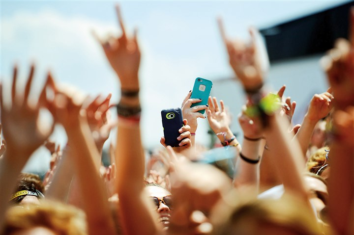 Concert goers record video and take pictures with cell phones Concert goers record video and take pictures with cell phones at the Vans Warped Tour at First Niagara Pavilion last Tuesday.