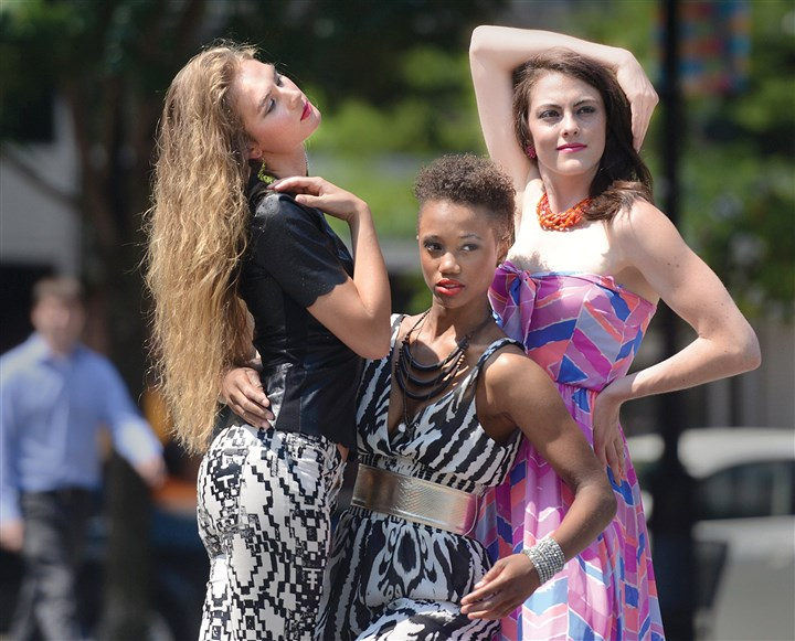 Kyla Stewart, Miyah Knight and Andrea Weinzierl Kyla Stewart, Miyah Knight and Andrea Weinzierl are photographed by photographer Michael Edwards during a pop-up fashion photo shoot in Market Square to promote Style Week Pittsburgh.