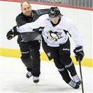 Penguins assistant Rick Tocchet works with prospect Oskar Sundqvist at development camp in July.