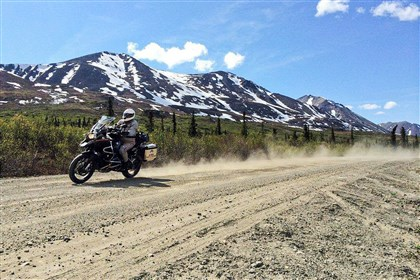 Chris Day on the Denali Highway of Alaska Chris Day churns up dust on the Denali Highway of Alaska. Eight friends decided to take an 865-mile ride around the state.