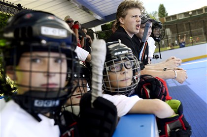 20140716rldPensProspects01 NHL first-round draft pick Kasperi Kapanen watches a scrimmage with members of the Brookline Youth Hockey League at Brookline Memorial Park on Wednesday, July 16, 2014. Kids ages 4-15 got the chance to run drills with six Pens prospects along with playing with them during a scrimmage.