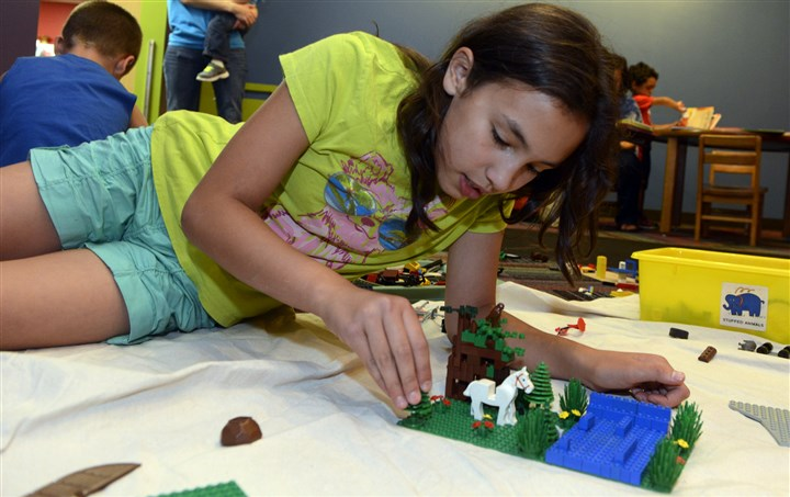 20140716bwLegoWest02-1 Cerina Wichryk, 11, of Oakdale, works on her landscape at the at the Western Allegheny Community Library.