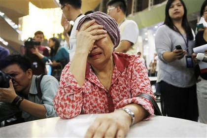 UKRAINECRISIS1-1 A woman, who said she believed her sister was on Malaysia Airlines flight MH17, cries as she waits for more information today about the crashed plane at Kuala Lumpur International Airport in Sepang.