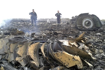 2014-07-17planecrash3 Emergencies Ministry members work at the site of a Malaysia Airlines Boeing 777 plane crash that occurred today in eastern Ukraine.