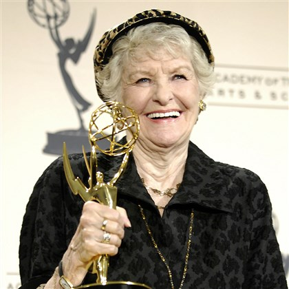 "AP070908045696-1 Elaine Stritch, is photographed with her award for guest actress in a comedy for her work on ""30 Rock,"" backstage at the 2007 Creative Arts Emmy Awards in Sept. 2007."