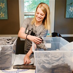 20140717ppGoShoutLove1BIZ Kristin Estok, the Glenshaw co-owner of Go Shout Love, packs up orders at her dining room table. The company, an online startup, sells apparel and accessories to benefit families with sick children.
