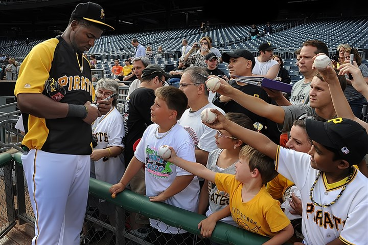20140717pdPiratesSports01-2 Gregory Polanco signs autographs during workouts at PNC Park after the All-Star break as the Pirates prepare to resume their season Friday.