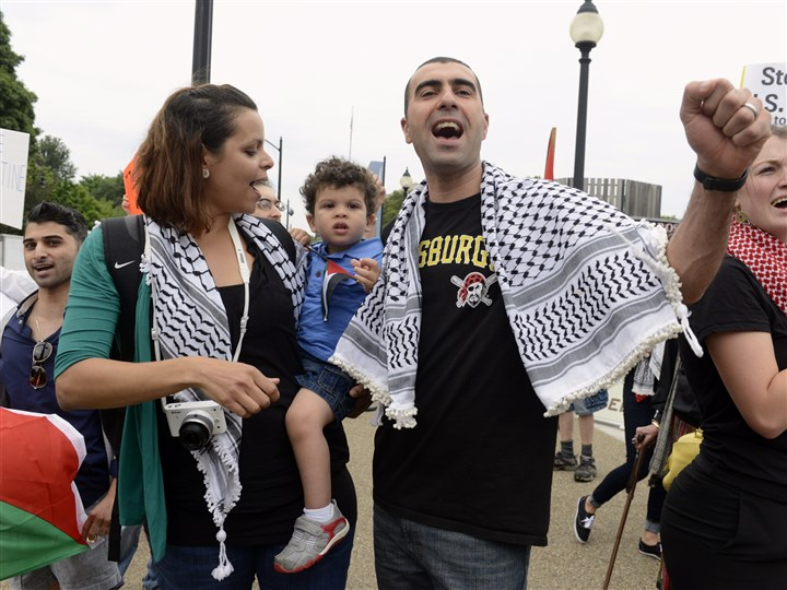 The Aburas family The Aburas family, Salma, two-year-old Sammy and Malek came to Mt. Lebanon from Palestine 11 years ago. They joined the rally in support of Palestinians in Gaza held Friday in Oakland.