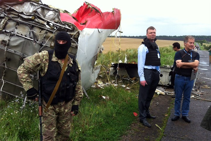 Malaysia Airlines crash site Alexander Hug, second from left, deputy chief monitor of the Organization for Cooperation and Security in Europe's Special Monitoring Mission to Ukraine, visits the crash site in east Ukraine.
