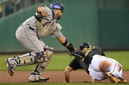 Gaby Sanchez is tagged out Gaby Sanchez is tagged out in a run down by the Rockies catcher Wilin Rosario at PNC Park Saturday.