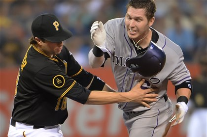 Second baseman Neil Walker Second baseman Neil Walker tags Rockies' Corey Dickerson as he tries to steal second at PNC Park Saturday night.